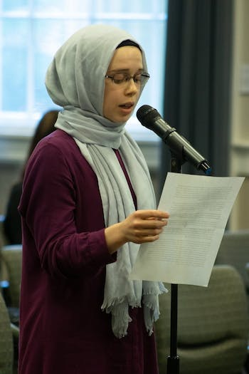 Lily Hebert , Ph.D. Student in the Department of Geography, speaks to the Chancellor's Search Committee out of concerns for the Muslim community on campus in Wilson Library on Sept. 18, 2019.