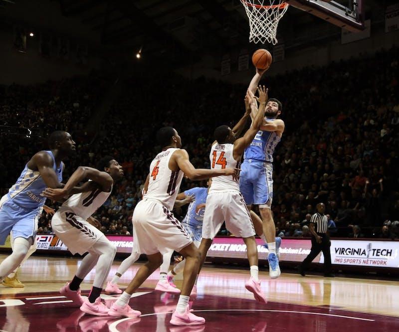 Forward Luke Maye (32) takes a jump hook against Virginia Tech on Jan. 22 at Cassell Coliseum in Blacksburg, Va.