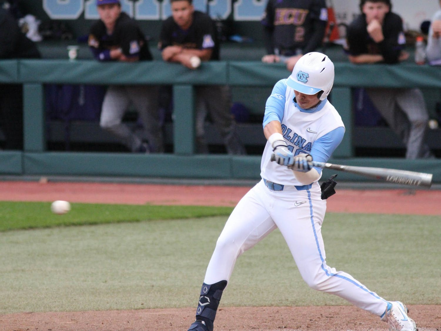 UNC redshirt sophomore outfielder Angel Zarate (42) offers at a pitch during the Tar Heels' game against East Carolina University at Boshamer Stadium on March 23, 2021. The Tar Heels defeated the Pirates 8-1.