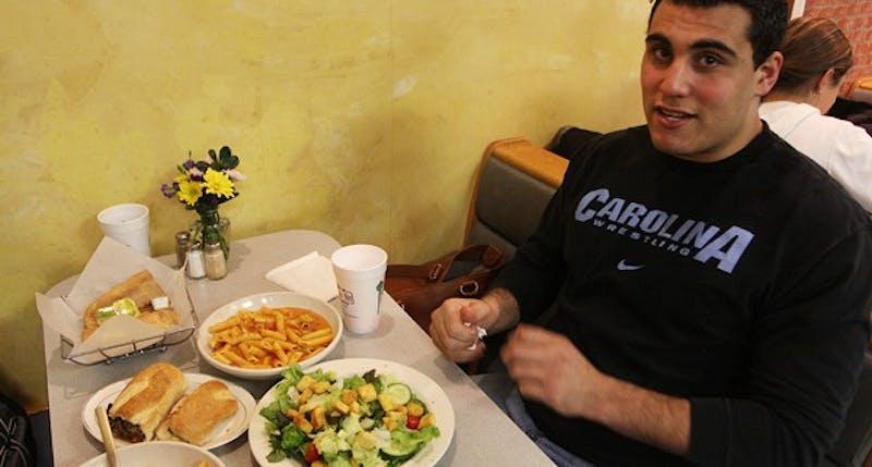 "UNC heavyweight wrestler Ziad Haddad orders ""the usual"" at Franklin Street Pizza & Pasta. DTH/Margaret Cheatham Williams"