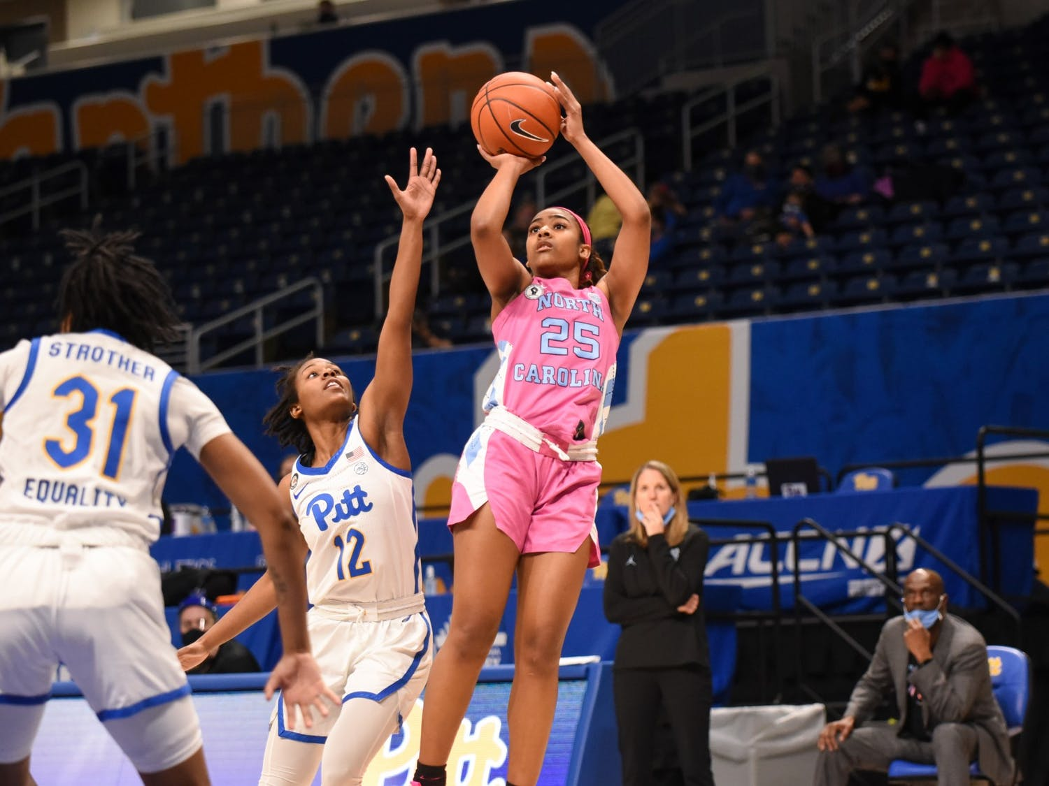 UNC first year guard Deja Kelly (25) attempts to make a shot during a game against Pitt on Sunday, Feb. 14, 2021. UNC beat Pitt 81-72. Photo courtesy of Matthew Hawley.