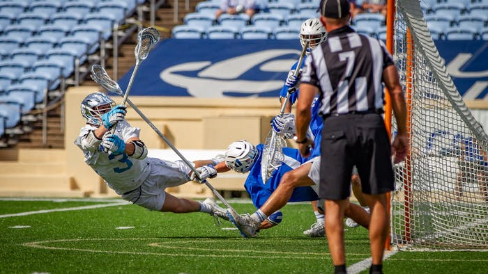 UNC senior midfielder William Perry (3) takes a shot on goal during the Tar Heels' 15-12 victory against Duke on Sunday, May 2. With the victory, UNC and Duke share the 2021 ACC regular season title.