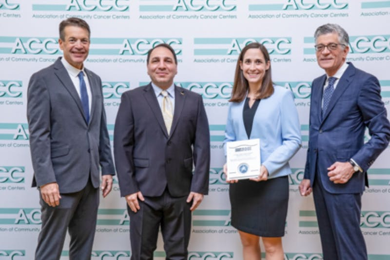 From left: Christian Downs, ACCC Executive Director; Ali McBride, ACCC President; Suzanne Francart, UNC Hospitals Department of Pharmacy, Assistant Director of Pharmacy; and Randall Oyer, ACCC President-Elect. The UNC Hospitals Department of Pharmacy received the 2019 Innovator award for a system that reduces financial risk for the hospital and its patients. Photo courtesy of Suzanne Francart.