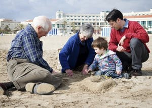 David Price sits with his wife Lisa, son Michael and grandson Charles on the beaches of Valencia, Spain in April 2009. Courtesy ofMichael Price.