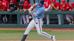 UNC redshirt sophomore outfielder Angel Zarate (40) hits the ball at the game against Louisville on Sunday May 16th, 2021 at Boshamer Stadium in Chapel Hill. The Tar Heels won 10-5.
