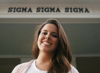 Ana Samper, a member of Sigma Sigma Sigma sorority, stands on the porch of her sorority house on Tuesday evening. Samper was elected president of the Panhellenic Council on Thursday night.