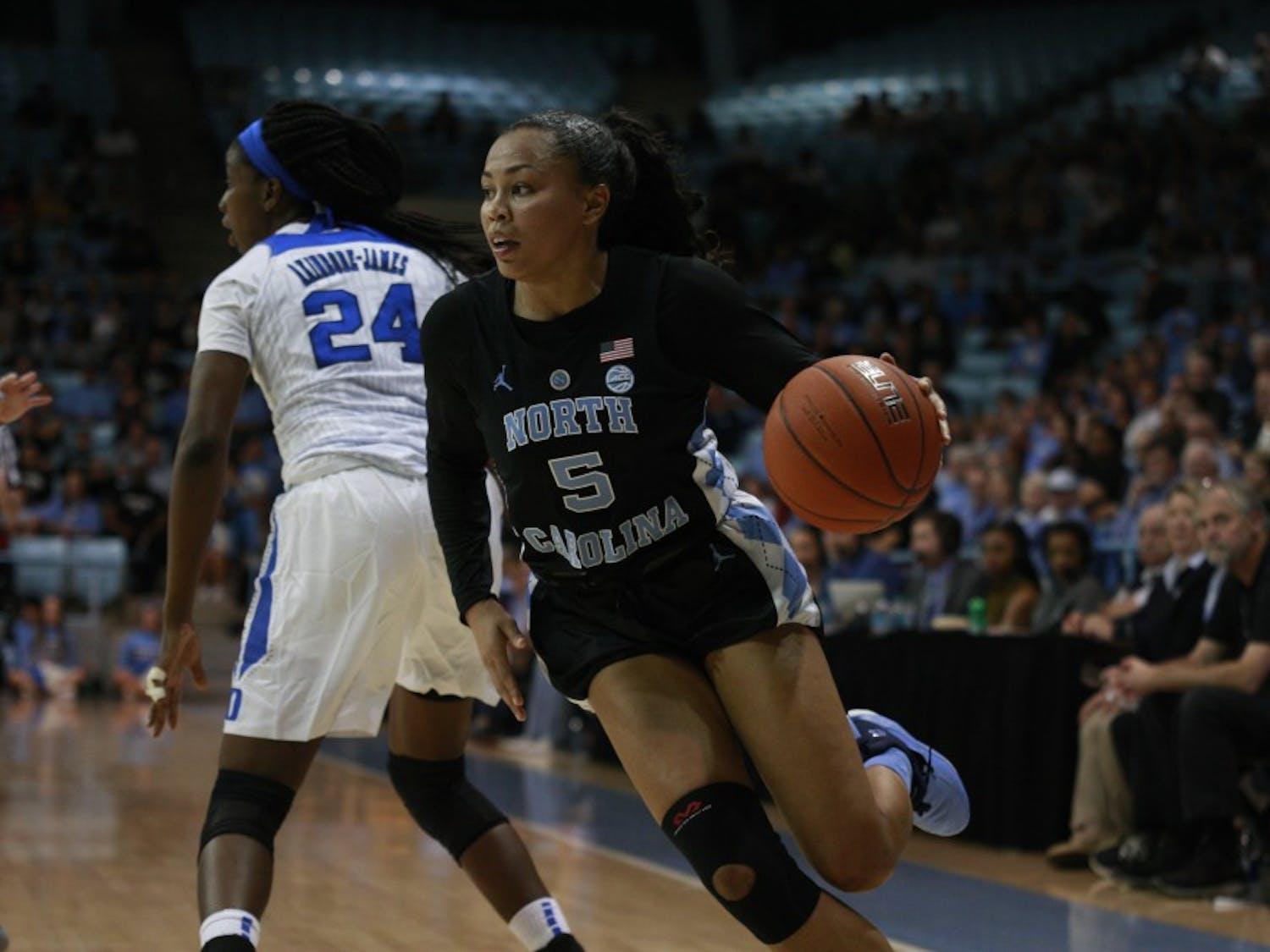 Redshirt junior Stephanie Watts (5) cuts across the court during a game against Duke in Carmichael Arena on Thursday, Feb. 7, 2019. UNC lost 69 to 85.