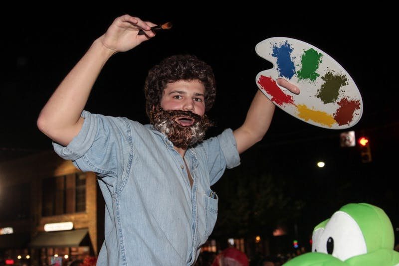 Hank Hultman poses as Bob Ross on Franklin Street.