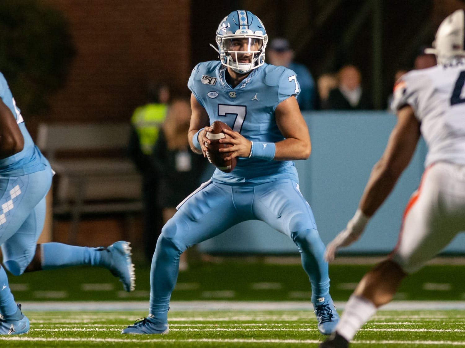 First-year quarterback Sam Howell (7) looks to make a pass during a game against UVA in Kenan Stadium on Nov. 2, 2019.