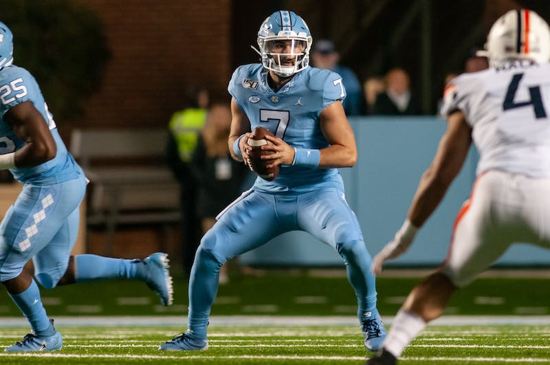First year quarterback Sam Howell (7) looks to make a pass during a game against UVA in Kenan Stadium on Nov. 2, 2019.