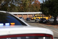 Students from Carrboro Elementary school are bused Carrboro Town Hall, where parents could check out their kids, on Tuesday Nov. 20 after an active shooter false alarm at the school. The police found no substance to the active shooter call.