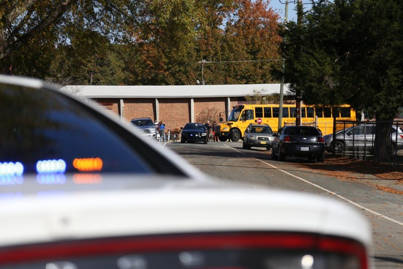 Students from Carrboro Elementary school are bused to Carrboro Town Hall, where parents could check out their kids, on Tuesday Nov. 20 after an active shooter false alarm at the school. The police found no substance to the active shooter call.