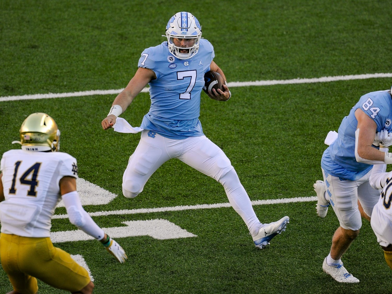 UNC's sophomore quarterback Sam Howell (7) runs the ball during a game against Notre Dame in Kenan Memorial Stadium on Friday, Nov. 27, 2020. Notre Dame beat UNC 31-17.