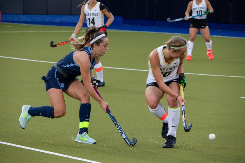 Junior forward Erin Matson (1) , tries to gain possession of the ball against Wake Forest on Friday, Oct. 30, 2020.