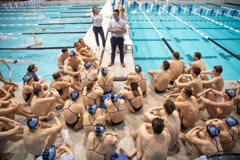 Head Coach Mark Gangloff gathers the swim and dive teams to deliver a post-meet speech following a loss to NC State in Koury Natatorium on Friday, Jan. 17, 2020. The Tar Heels' fell to the Wolfpack 187.5-112.5 in men's and 182-118 women's.