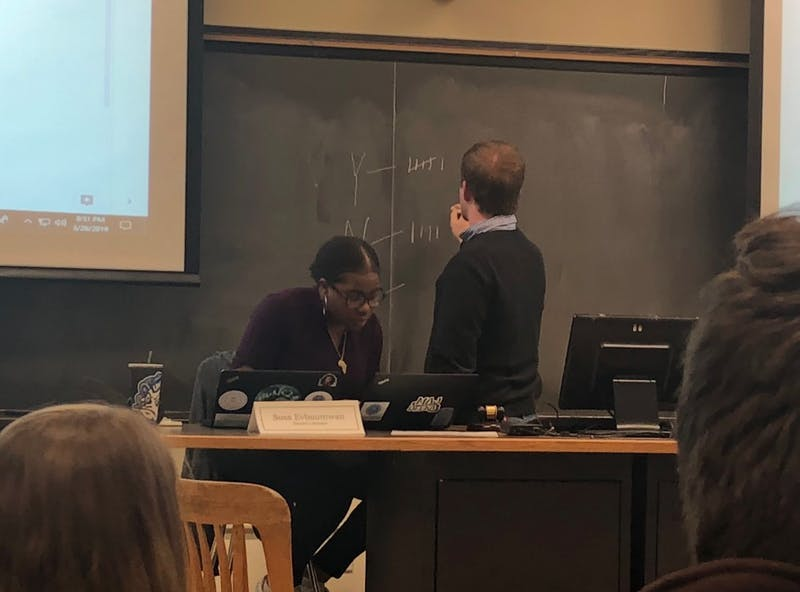 Speaker Stephen Wright and Senator Sosa Evbuomwan take a role call vote during the Undergraduate Senate's March 26 meeting.