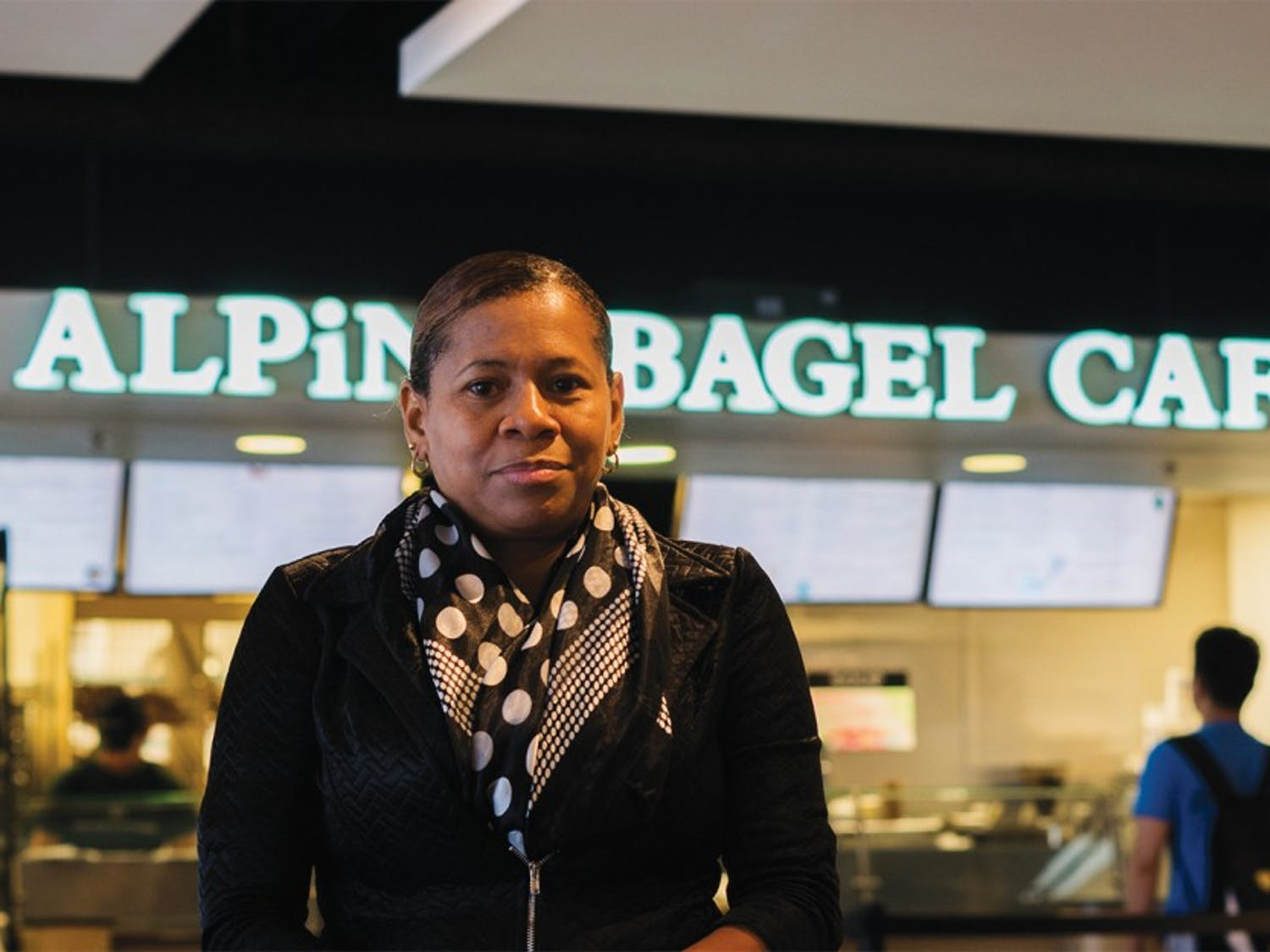 Lezlie Sumpter, a former employee of Alpine Bagel Cafe in the Student Union, poses in front of the storefront. Sumpter believes she was wrongfully fired.