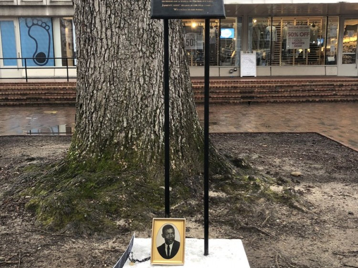 The dedication plaque for James Cates, the UNC student who was stabbed to death by a white supremacist group in the Pit in 1970.