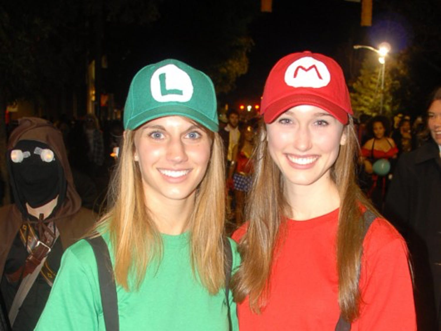 """Jillian Froelick, left, and Lauren Swords, right, pose as Luigi and Mario. """"Other Marios and Luigis are very welcoming,"""" Froelick said.  Swords and Froelick said they had seen over 20 other Mario and Luigis."""