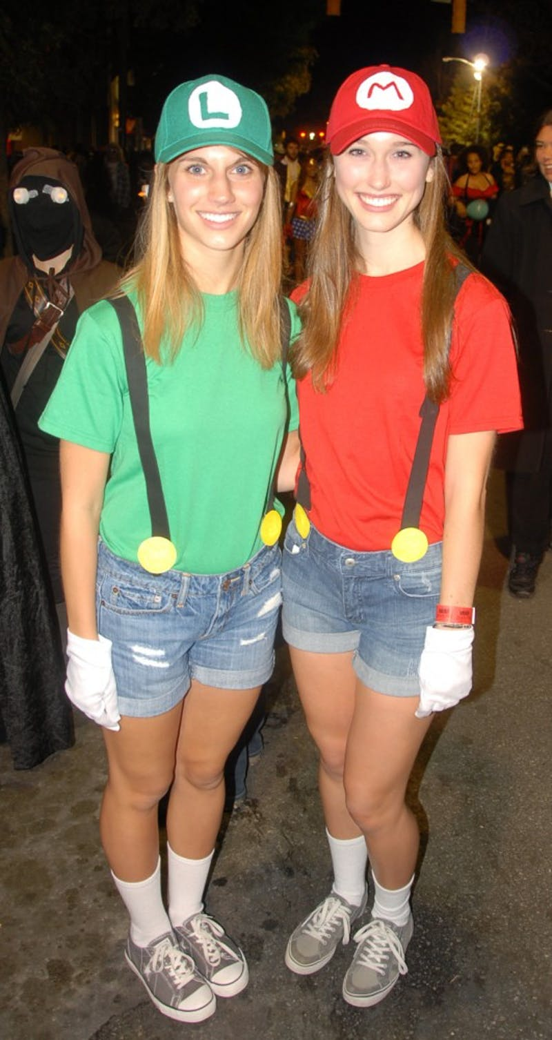 "Jillian Froelick, left, and Lauren Swords, right, pose as Luigi and Mario. ""Other Marios and Luigis are very welcoming,"" Froelick said.  Swords and Froelick said they had seen over 20 other Mario and Luigis."