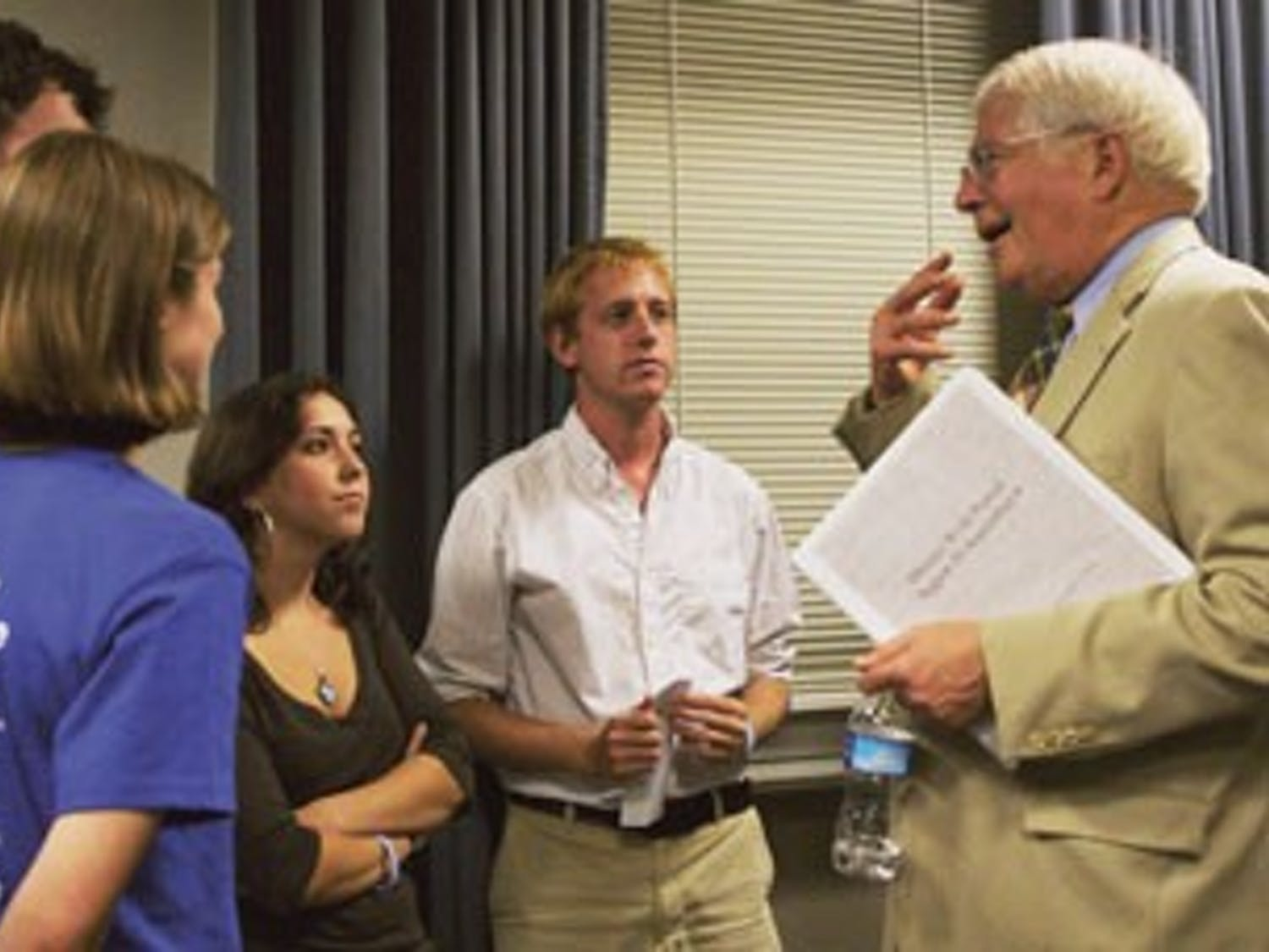 Congressman David Price speaks to students after giving a speech about health care in Wilson Library Wednesday.