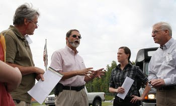 Kermit Williamson (Environmental Services Superintendent) talks to local officials about the Asheboro Transfer Station's facility and consolidation operations.  (Pictured L to R: Jim Ward, Chapel Hill councilman; Kermit Williamson; Cathy Wilson, Carrboro Town Clerk; Richard Seiz, Chapel Hill town member)