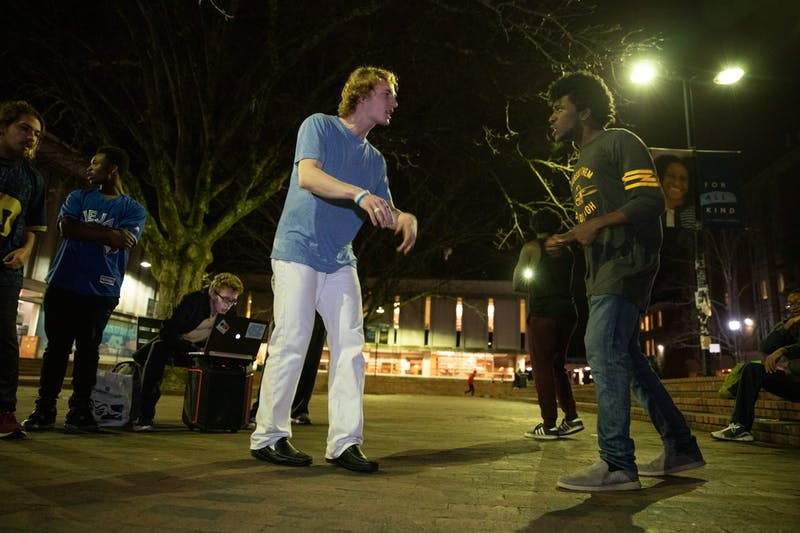 "Michael ""Lord Goose"" Seethaler and Justis ""Justis Ryan"" Malker, members of the weekly freestyle group Cypher, rap-off in the Pit at UNC-Chapel Hill on January 15, 2020. ""We don't care if you're Jay-Z or if you don't even consider yourself a good rapper,"" he said. ""Like, there are times where the mission is not to be good. The mission is to be real, to be authentic."""