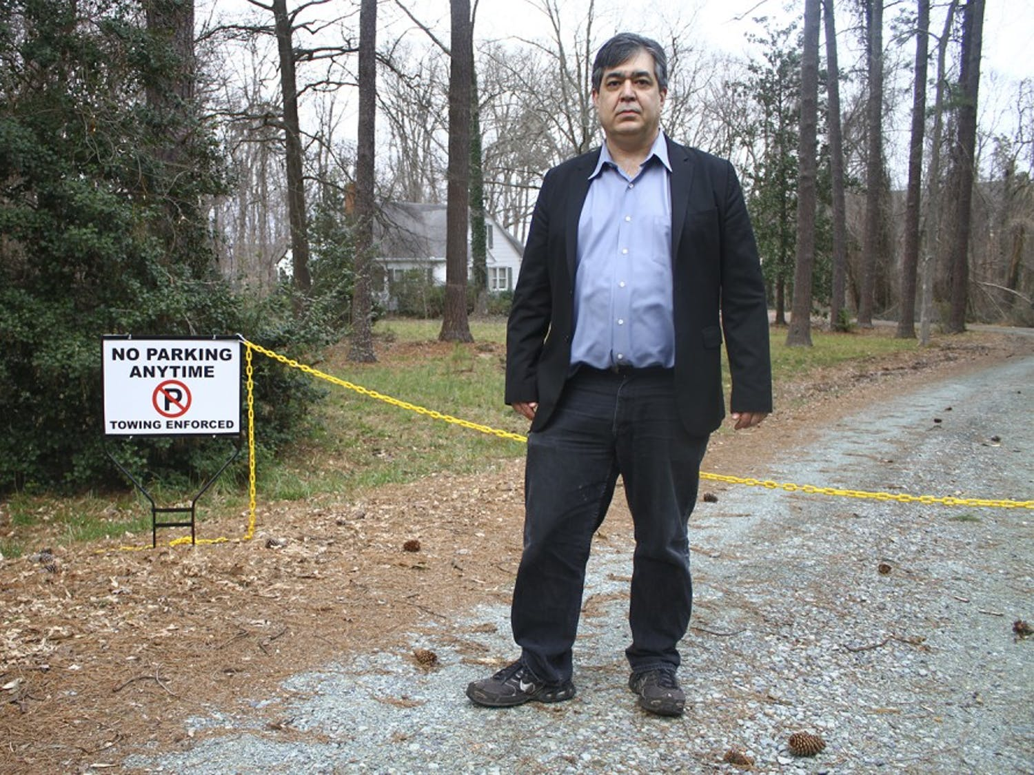 Eric McAfee, Chapel Hill resident, stands at the entrance of his former driveway.