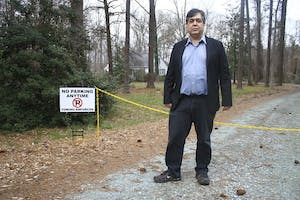 Chapel Hill resident, Eric McAfee, stands at the entrance of his former driveway.