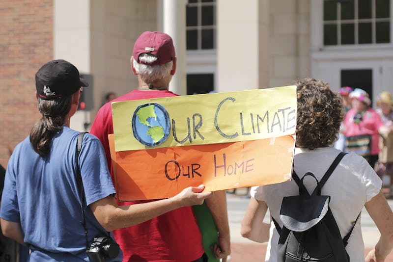 The Raging Grannies, Solarize Chapel Hill and other local advocacy groups protest climate change at Peace and Justice Plaza on Sunday afternoon.