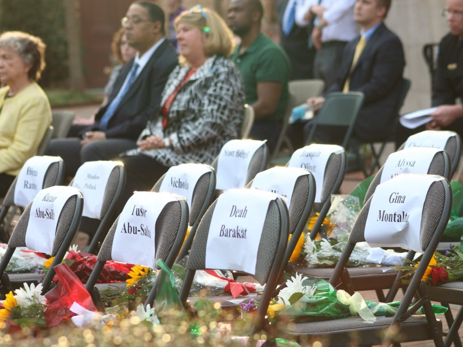 Seats and flowers were set out on stage in honor of the seventeen students of Marjory Stoneman Douglas High School during the UNC Rally for Our Lives event in Polk Place on Wednesday evening.