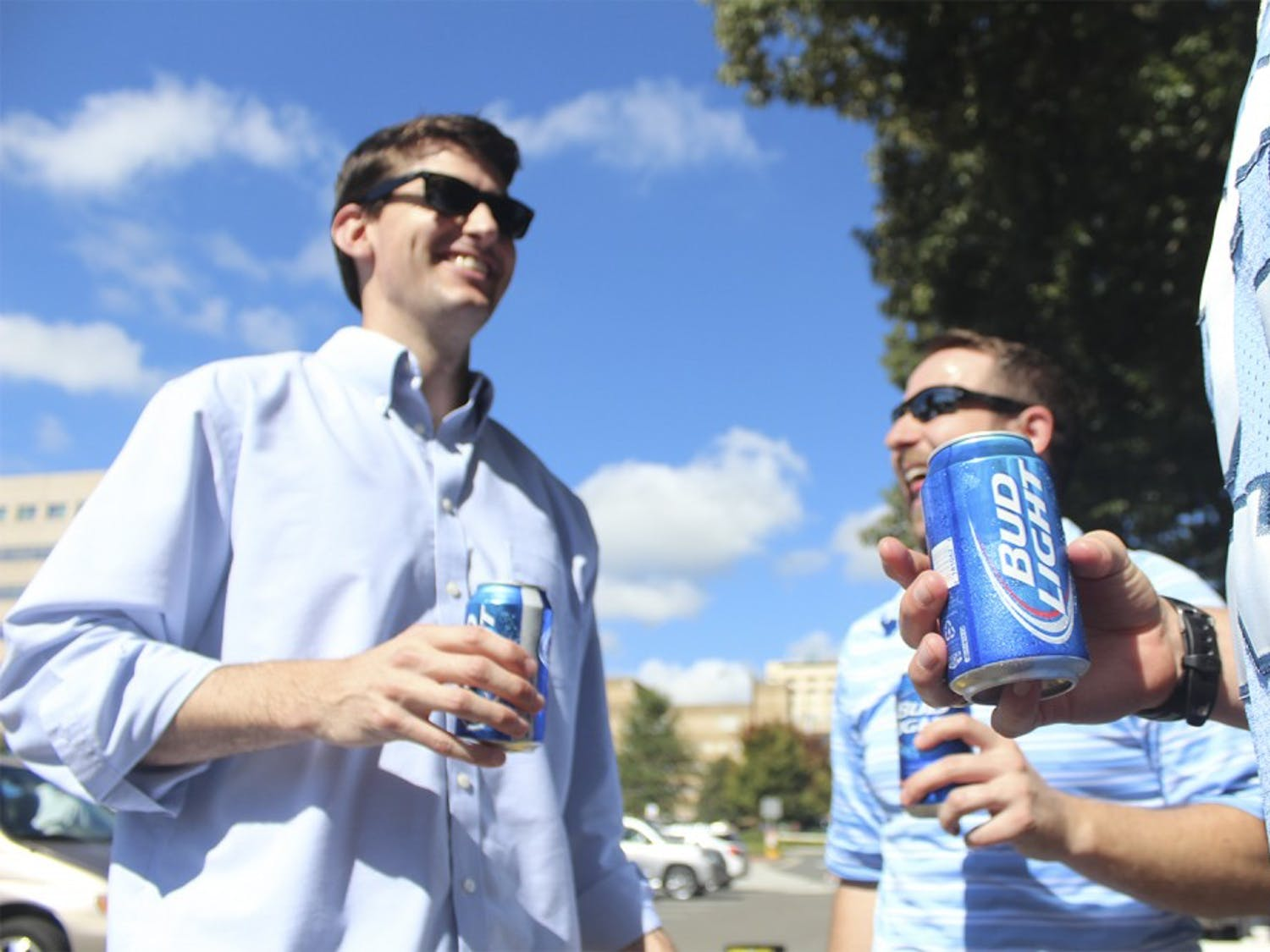 Tailgating: Trent Womble (left) from Raleigh and John Russell from Cary (right) enjoy a beer with friends