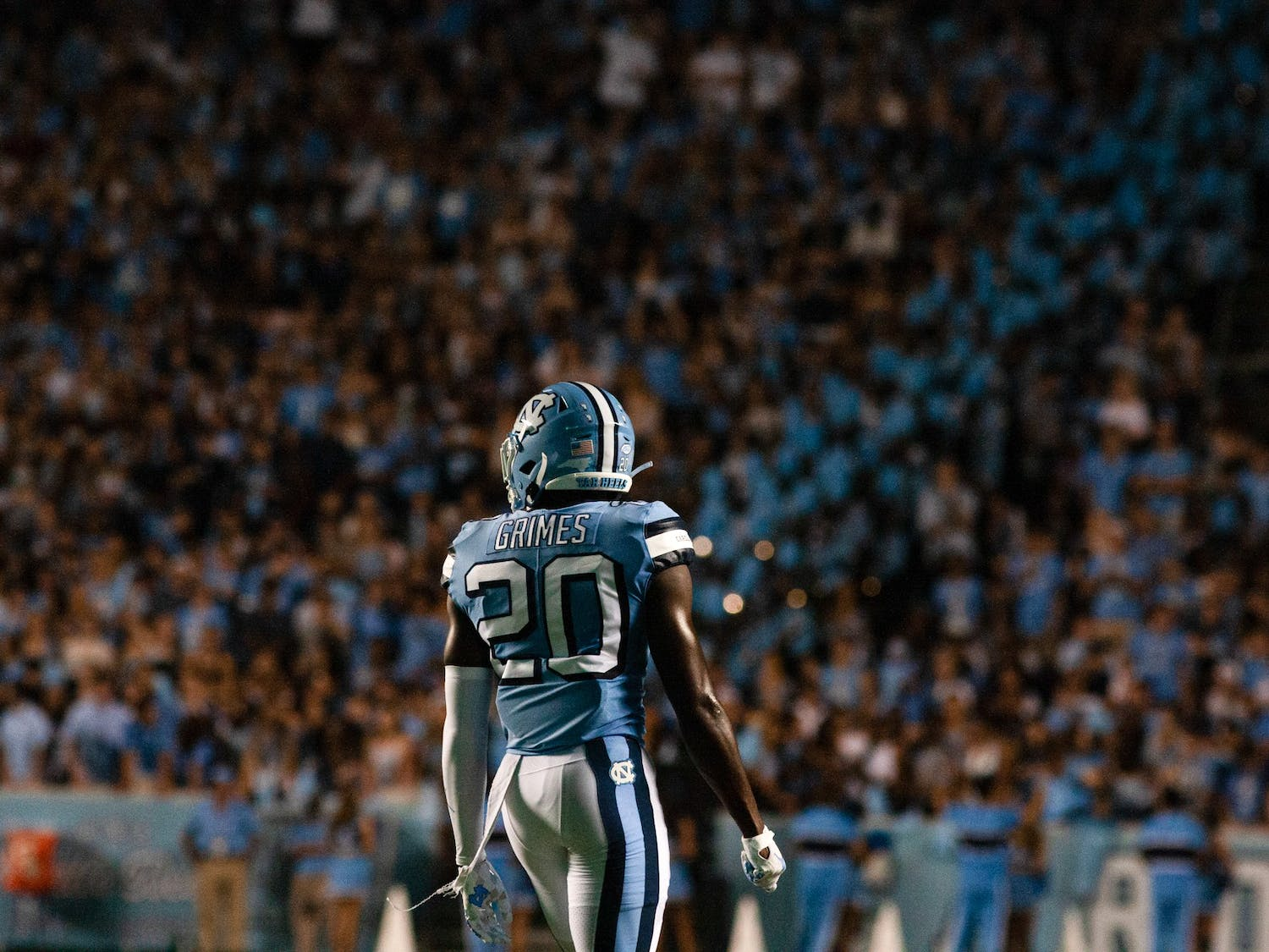 UNC sophomore defensive back Tony Grimes (20) stares into the crowd at Saturday's home game at Kenan Stadium. UNC defeated the Cavaliers 59-39, their second win of the season.