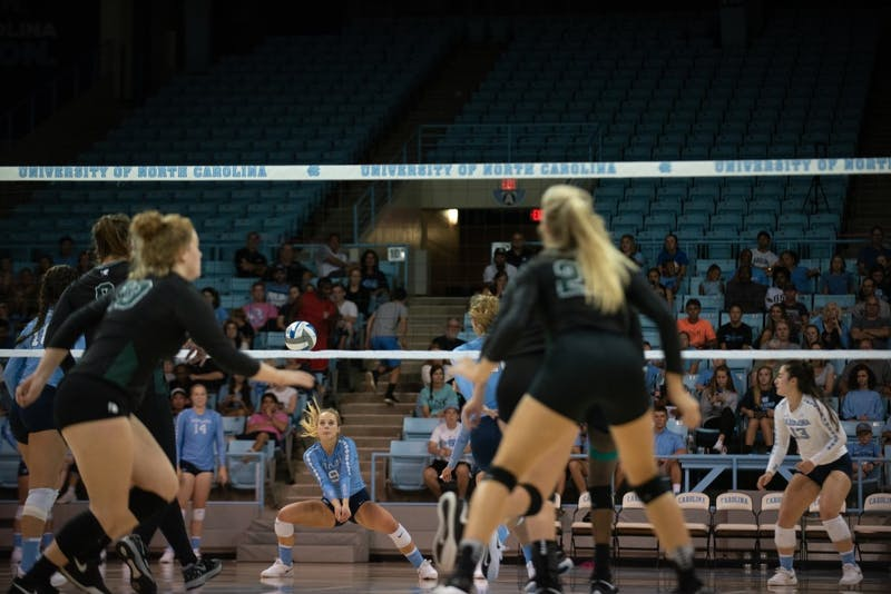 Defensive specialist Greer Moseman (9) gets a dig against Michigan State during a Sept. 1 loss in Carmichael Arena.