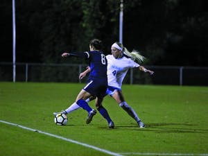 Forward Bridgette Andrzejewski (4) fights for the ball against Notre Dame on Thursday night at WakeMed Soccer Park in Cary.