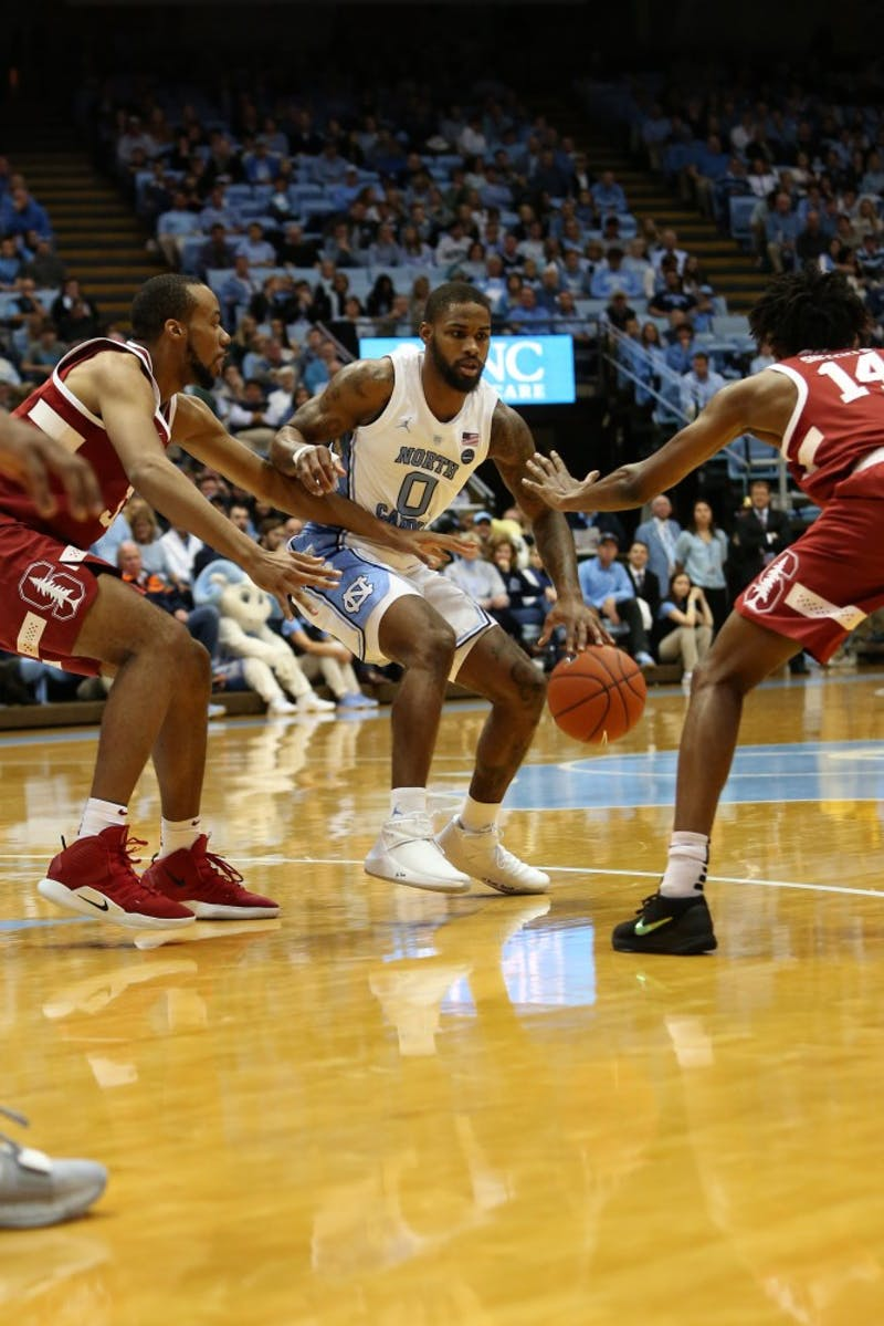 UNC guard Seventh Woods (0) advances the ball against Stanford in the Dean Smith Center on Monday, Nov. 12, 2018. UNC won 90-72.