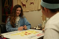 (From left to right) Kara Cody, a senior exercise and sport science and psychology major, and Jaycee Reilly, a senior exercise and sports science and romance languages double major, prepare a poster board on Tuesday, February 5, 2019 for the SOAP project event on Friday, February 8, 2019 in the Pit. The SOAP project raises awareness about human trafficking. The event will encourage students to place labels with a human trafficking hotline on bars of soap. The soaps are then placed in hotels to help victims get help.