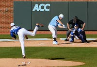 UNC first baseman Cody Stubbs (25) makes contact with the ball.
