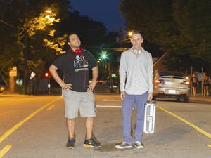 Rob Sekay (left) and Trevor Dougherty, seniors, are two student DJs who oppose local bars having ladies' nights.