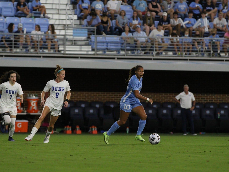 UNC Senior forward/midfielder Rachel Jones (10) runs with the ball during the Duke vs UNC soccer game on Sept. 17. The Tar Heels lost 1-0.