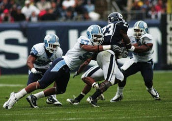 Dion Guy (57) tackles UConn's Jordan Todman in UNC's 12-10 victory against the Huskies.
