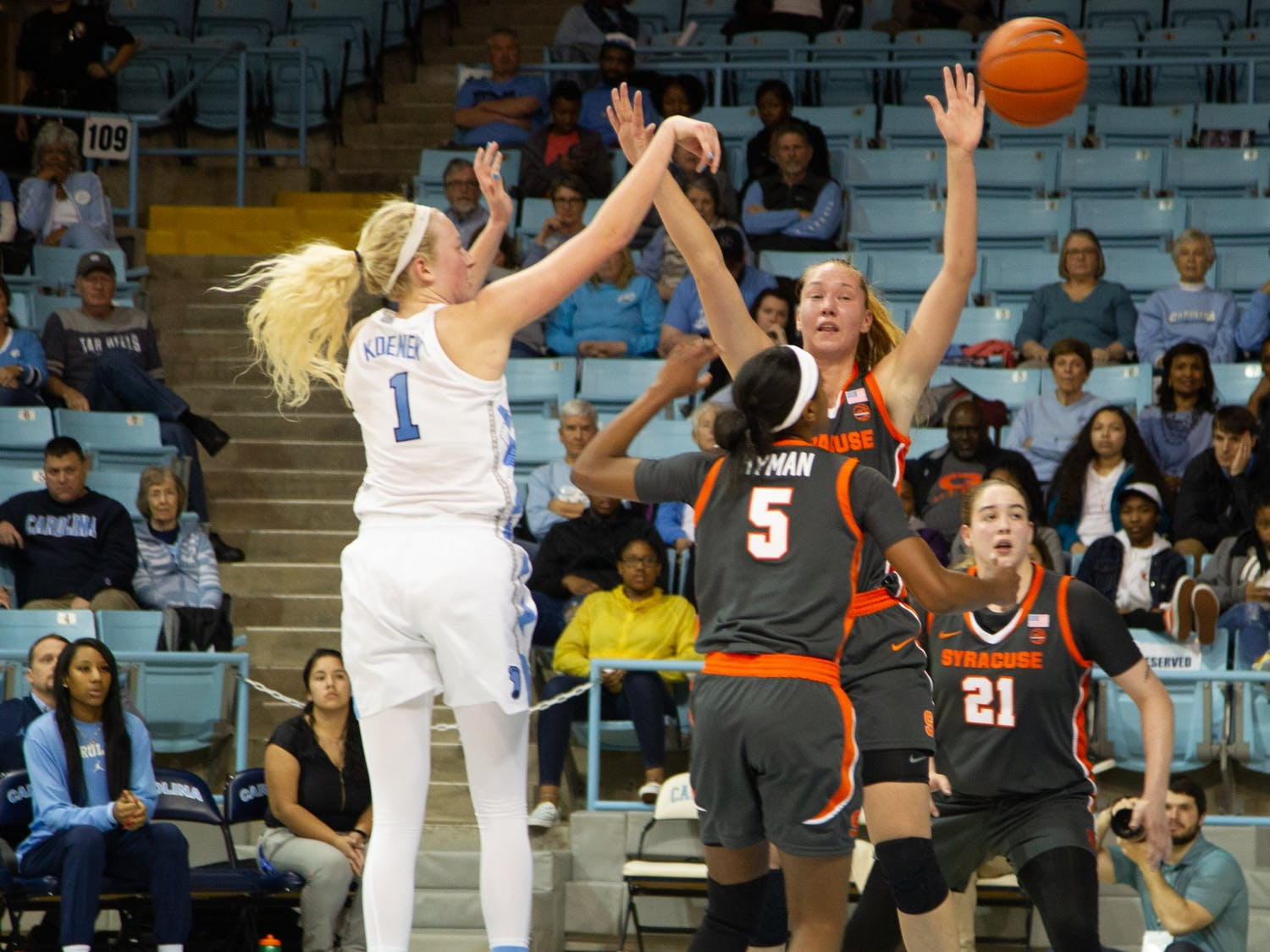 UNC senior guard Taylor Koenen (1) attempts a three-pointer while Syracuse players try to block during a game in Carmichael Arena on Thursday, Feb. 13, 2020. The Orange beat the Tar Heels 74-56.