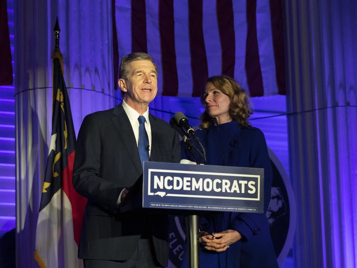 Gov. Roy Cooper and First Lady Kristin Cooper announce their victory in the 2020 election on Nov. 3, 2020 on the steps of the N.C. Democratic Party headquarters in Raleigh.