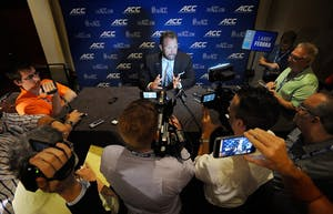 North Carolina football head coach Larry Fedora speaks with the media at the 2017 ACC Football Kickoff in Charlotte on Friday (Photo by Sara D. Davis, theACC.com)
