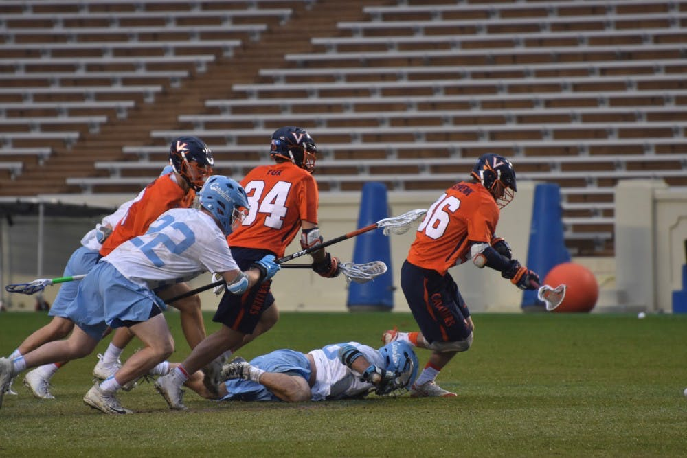 <p>Virginia and North Carolina players chase the ball on April 7, 2018 in Kenan Stadium.</p>
