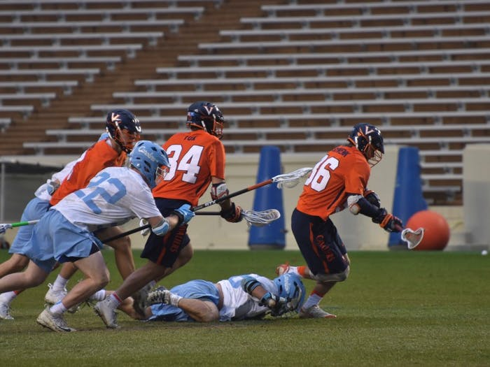 Virginia and North Carolina players chase the ball on April 7, 2018 in Kenan Stadium.