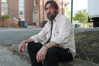 Tommy Keeter sits outside the IFC, a local homeless shelter located on Rosemary Street. Keeter says the IFC has several services available for the homeless, including medical and psychiatric care.