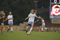 UNC junior midfielder Annie Kingman (7) dribbles downfield during the Thursday night game against Virginia Tech.