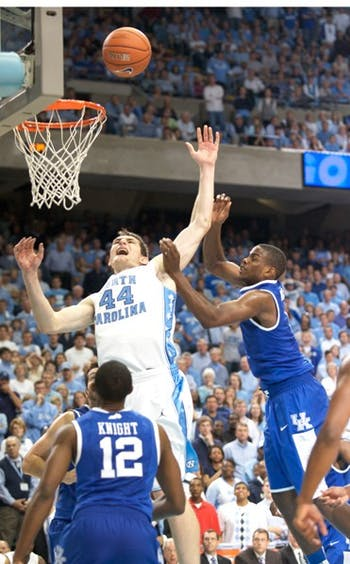 Junior Tyler Zeller is fouled by Darius Miller in Saturday's physical game. UNC went 9-for-10 from the charity stripe in the foul-heavy final 81 seconds of play.