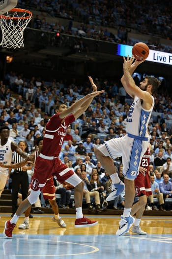 UNC forward Luke Maye (32) shoots over Stanford forward Jaiden Delaire (11) in the Dean Smith Center on Monday, Nov. 12, 2018. UNC won 90-72.